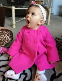 In her new winter coat.