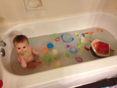 All her new bath toys in the tub all at once!
