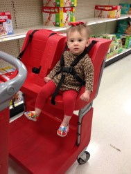 Shopping with Mama at Target. SItting in the new carts!