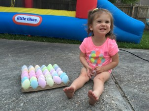 Happy with her dyed eggs for Easter 2015.