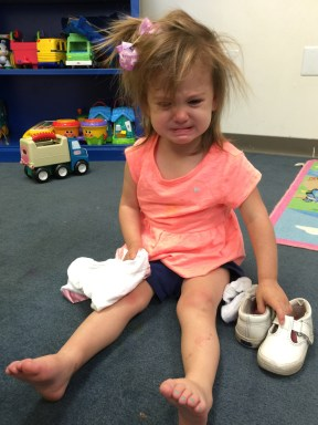 Claire hurt her foot (and sent us to the doctor and xrays several times). Her teacher sent me this because we were told not to hold her. She was not happy!