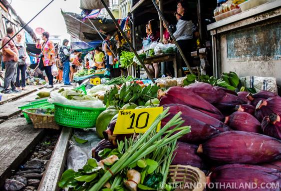 Produce sitting on the tracks of the Maeklong Railway Market