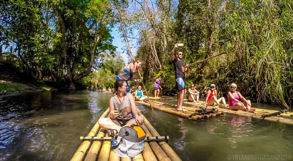 Many people bamboo Rafting in Chiang Mai on a hot day