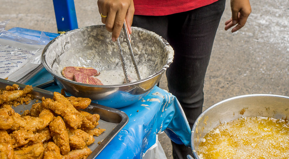Sweet and crispy fried bananas are safe to eat from a Thai food stall