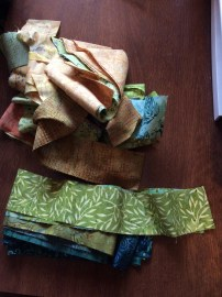 Bali Pop of 2 1/2 inch strips pulled apart for quilt