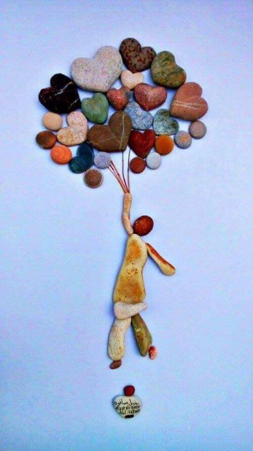 cuadro de niño con globos en piedras