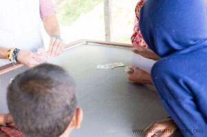 "Teaching the classic card game ""War"" on a Nepali hillside"