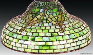 Tiffany Tyler Shade 16 inches diameter. Dell shaped shade. Green-white striated with Tyler scrolls. Estimated $8,000 - 10,000.