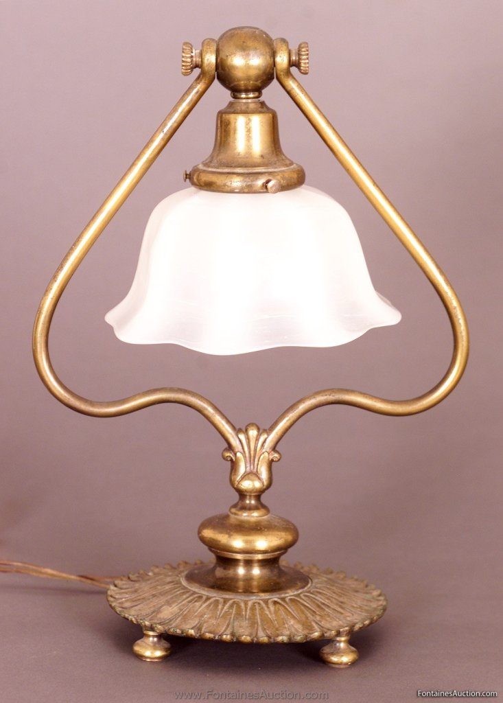 Tiffany White Glass Harp Table Lamp. 13.5 inches high, 5 inches diameter shade. A fluted white shade with highlights of pink and blue when light the shade hangs & pivots. Base is signed 419 Tiffany Studios New York. Estimated. $3,500 - 4,500.