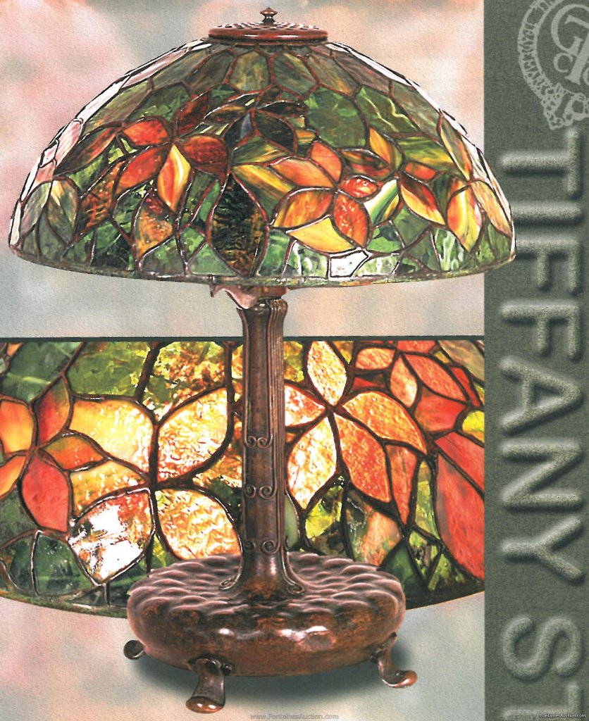 Tiffany Woodbine Table Lamp 16 inches diameter. Shade is loaded with confetti glass in the background. Also dichroic glass is throughout. Estimate $35,000
