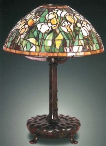 Tulip Tiffany Leaded Table Lamp. 22 inches high, 16 inches, shade 7 inches diameter. The shade is signed Tiffany Studios New York. Estimated: $25,000 - 35,000.