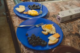 Josh's boxes don't actually arrive until late September to his dismay, but his parents & aunt were kind enough to pack him some of the essentials, hence the plastic blue plates. He made us a quick breakfast of eggs, blueberries, & some cheese we took from our museum trip the day before.