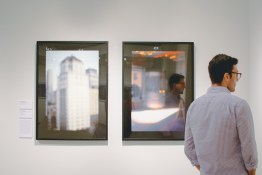 Josh observing museum photos.