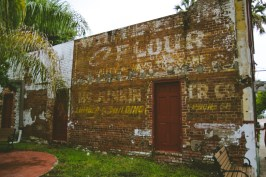 A decrepit brick building on the island sat alone, asking for a photo.