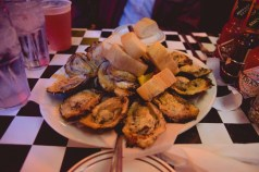 A dozen chargrilled oysters, perfectly delicious.