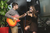 Isabella was hired to sing at the party, but Eric joined in to play the guitar while she sang songs.