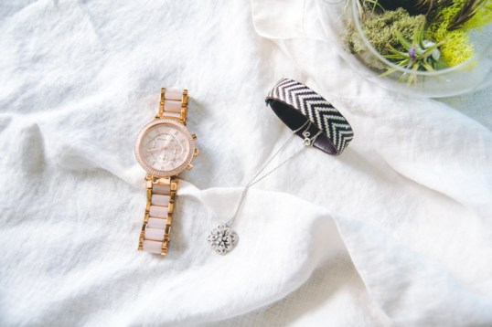 Michael Kors Rose Gold watch, some fancy diamond necklace, & a bracelet from Colombia