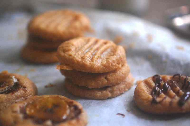 Peanut butter cookies on baking paper on a tray