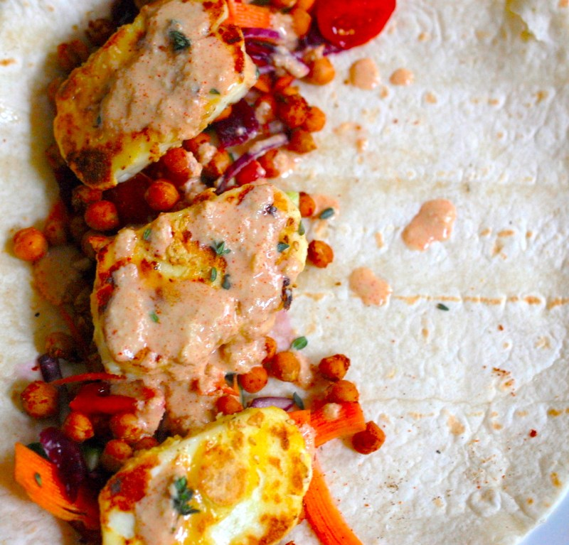 Chickpea, sweet potato and Halloumi wrap laid open on plate