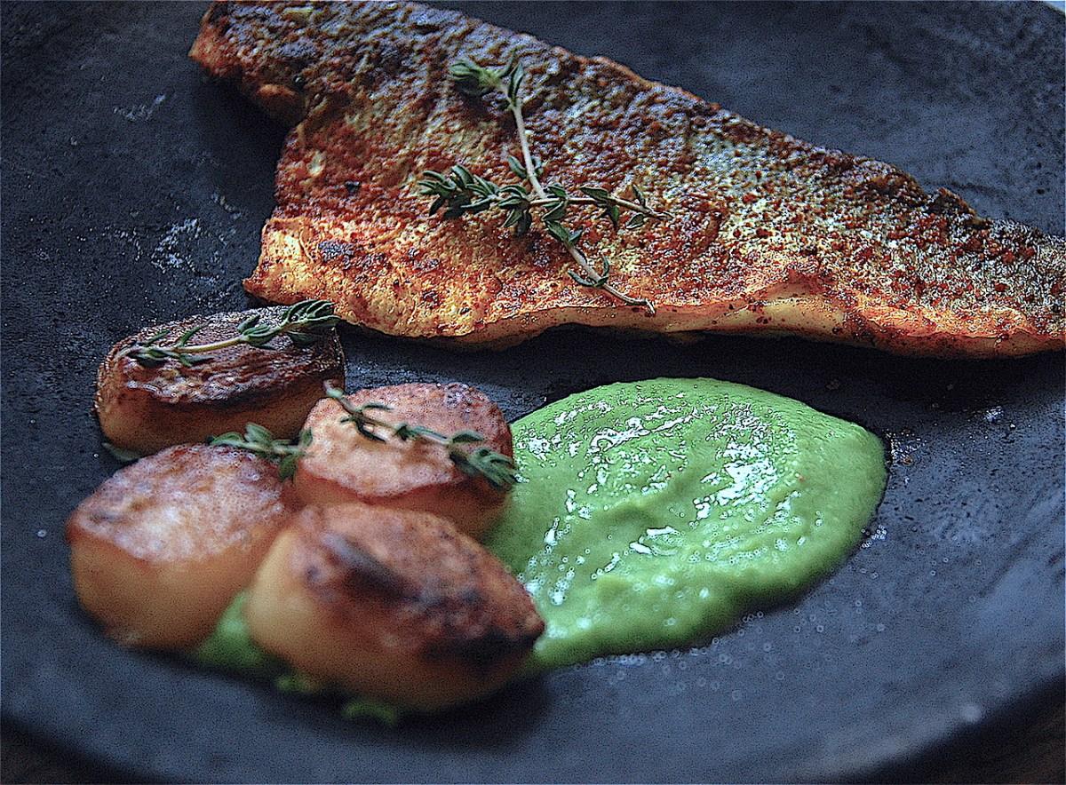 crispy sea bass, fondant potatoes and pea puree