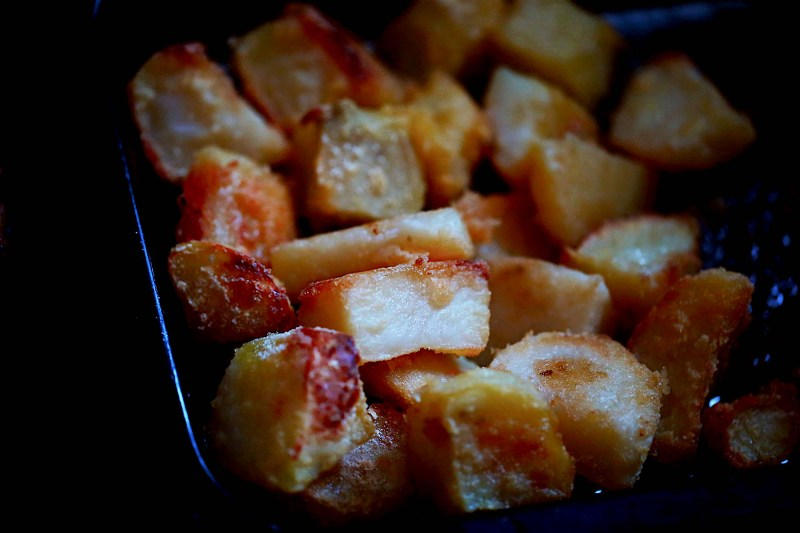 Home Made Aunt Bessie Style Roast Potatoes in a baking tray