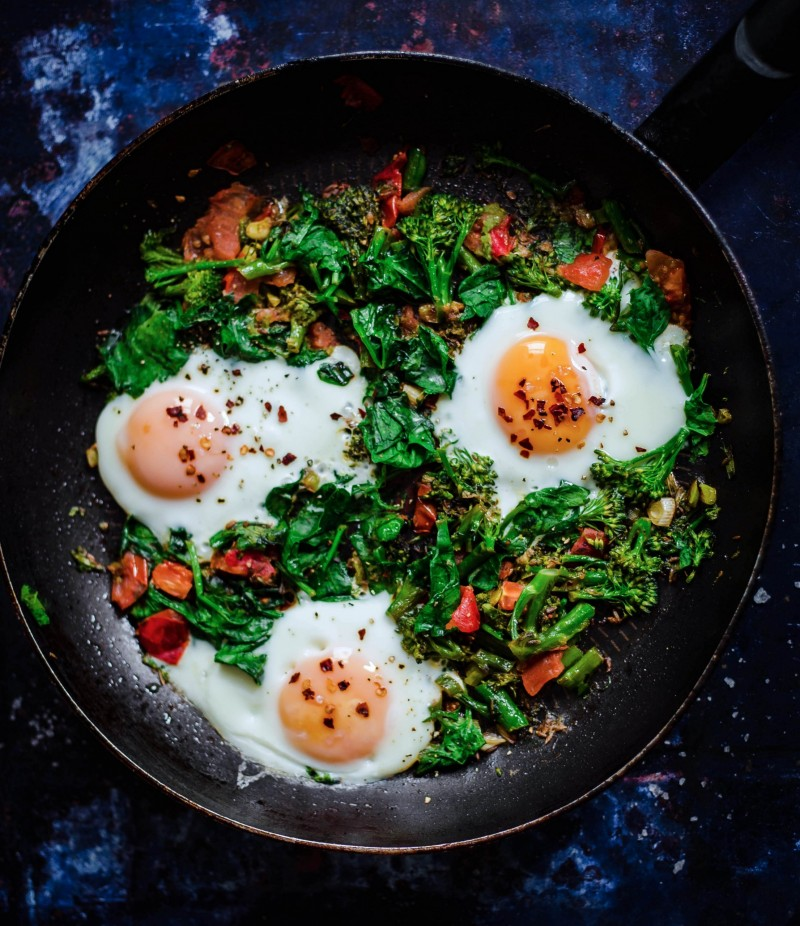 Broccoli, Spinach, Tomato and Eggs cooked in frying pan