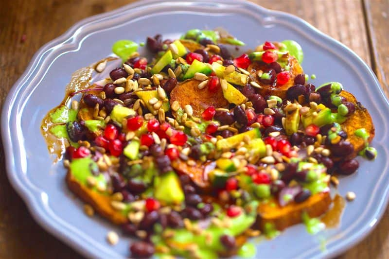 Sweet Potato slices and Black Bean Chaat on a plate