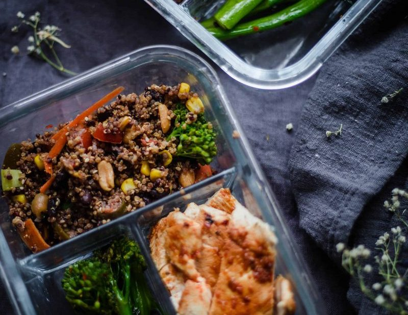 Chicken, Quinoa and Broccoli in sectioned glass containers