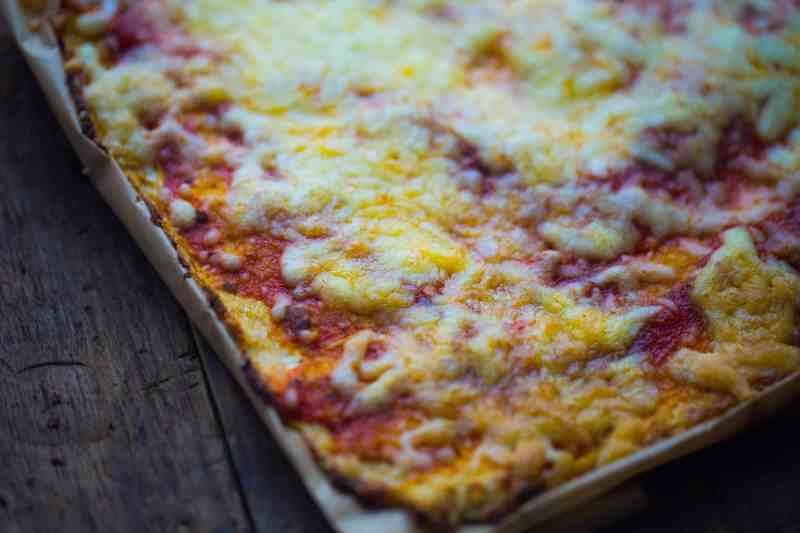 Cauliflower Pizza base topped with pasta and cheese