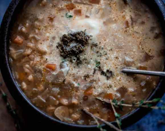 Vegetarian Pearl Barley Soup in dark bowl with spoon