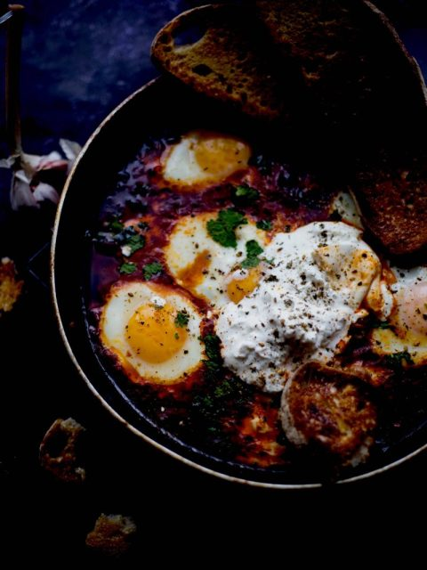 Middle Eastern Shakshuka with Burrata in pan with sourdough toast
