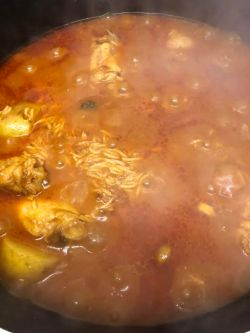 Rice, Chicken and Potato bubbling in pot