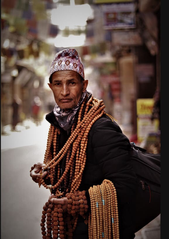 Muslim Man with mosque hat carrying multiple tasbeehs/rosary