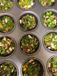 Vegetables divided into muffin tin sections