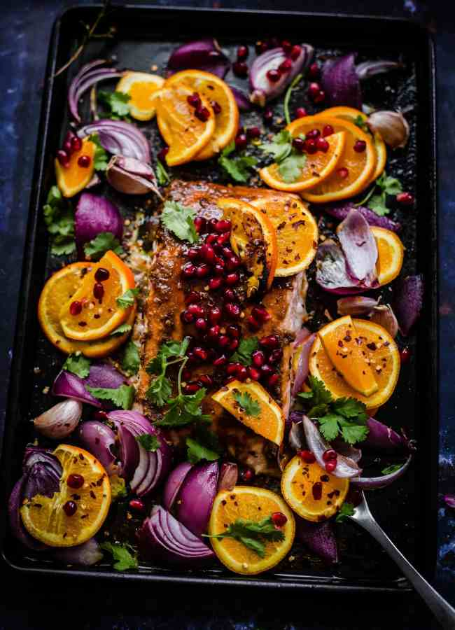 Pomegranate and Orange salmon with red onions in tray