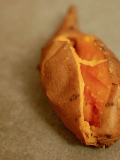 Baked Sweet Potato n grey background