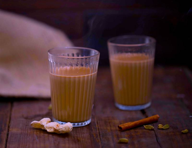 2 cups of Chai with spices around them