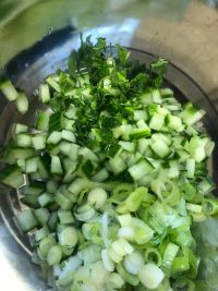 Cucumber, Spring Onions and chopped parsley in a bowl