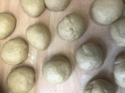 Dough balls on floured work surface
