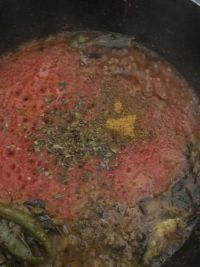 Tomatoes cooked and dry fenugreek added to pot
