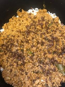 Another layer of keema and dal added on top of rice layer