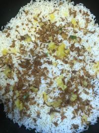 Final rice layer with ghee and onions on top
