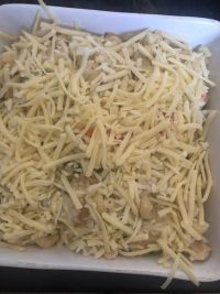 Pasta bake with Cheese added to deep square dish