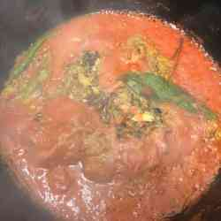 Tomatoes simmering in pot