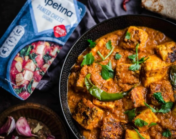 Masala Paneer in a bowl with roti t side