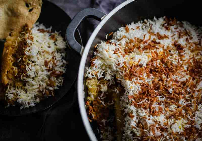 Keema Rice in large pot with a portion in bowl to side