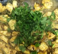 Cooked Chicken and coriander in pan