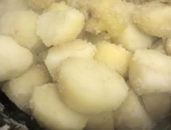 Potatoes steaming in pot
