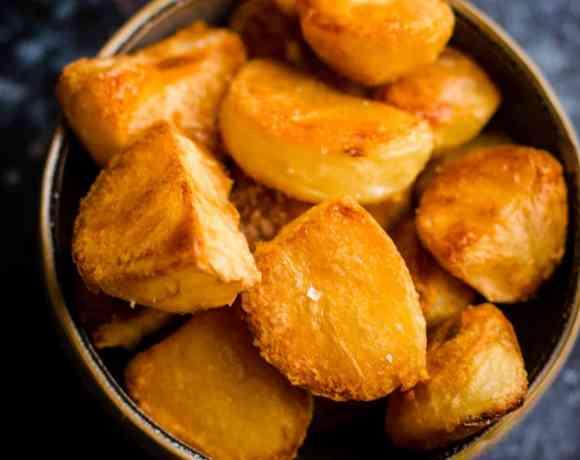 Crunchy roast potatoes in a bowl