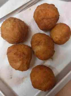 Donuts in cinnamon sugar in tray